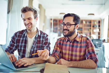 office man: Young businessmen looking for new data in office