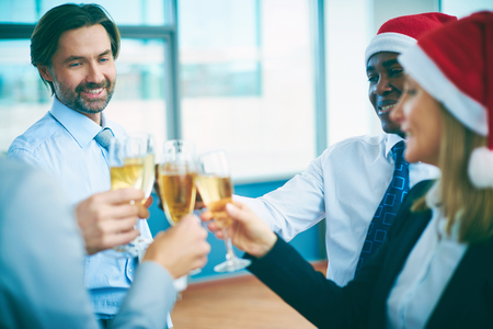 christmas party: Multi-ethnic business people with champagne celebrating Christmas at office party