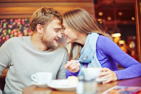 amorous: Amorous couple relaxing in cafe