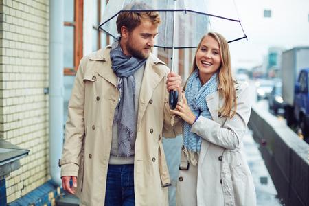 amorous woman: Amorous man and woman walking under umbrella