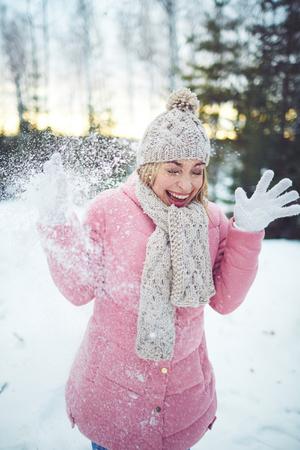 winterwear: Laughing girl in winterwear having fun outside
