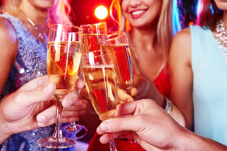 girl friend: Group of friends clinking with flutes of champagne at party