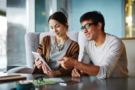 explaining: Young man explaining data to his girlfriend Stock Photo