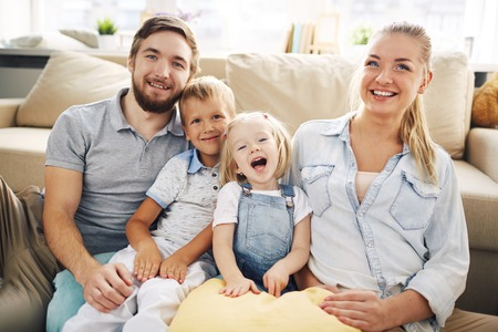 family and home: Happy family spending weekend at home