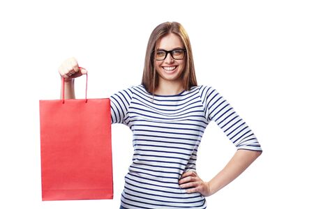 paperbag: Happy customer with red paperbag looking at camera