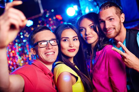 nightclub: Young friends making selfie during party in nightclub Stock Photo