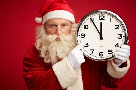 night before christmas: Santa showing at clock before Christmas night