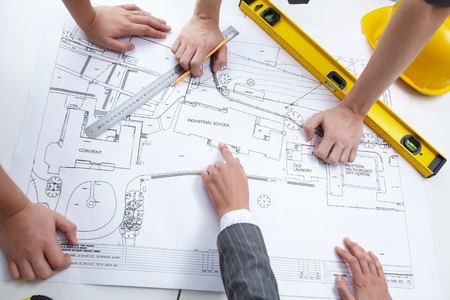 team hands: Engineers discussing draft of constructions
