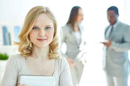 Blond businesswoman looking at camera photo