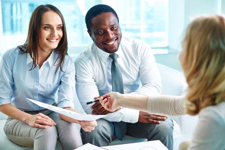 explaining: Businesswoman explaining her partners data in document