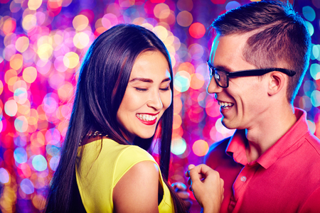 clubber: Cheerful couple laughing at party Stock Photo
