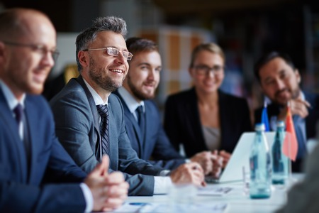 Successful businesspeople sitting at conference or seminar during lecture Banque d'images