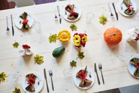 Ripe vegetables, glassware and tableware on served festive table