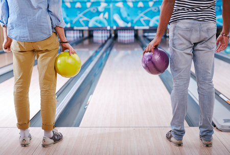 competitive sport: Young people in casualwear standing in bowling alley