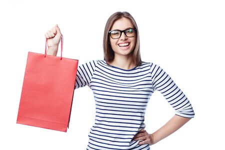 paperbag: Young shopper in eyeglasses holding red paperbag