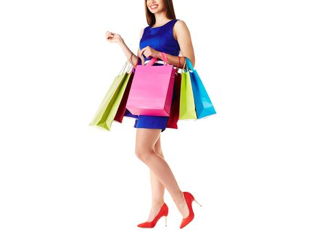 paperbags: Young shopper in dress and elegant shoes holding paperbags