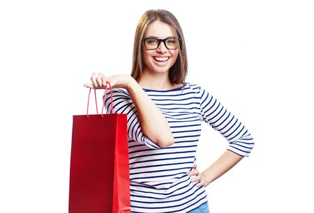 paperbag: Happy shopaholic with paperbag looking at camera with smile Stock Photo