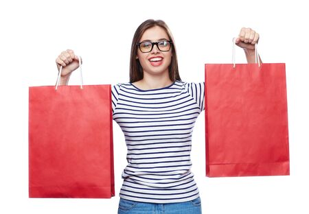 after shopping: Happy buyer with paperbags looking at camera after shopping Stock Photo