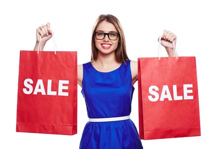 paperbags: Elegant shopper in blue dress holding two sale paperbags Stock Photo