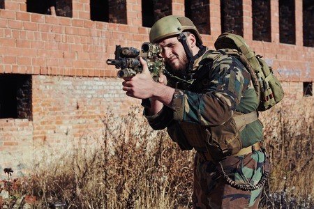 outside shooting: Special army soldier with gun shooting outside