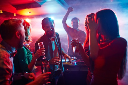 clubber: Group of friends with champagne having party in club