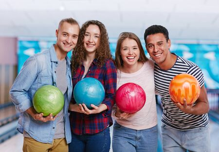 people laughing: Portrait of best friends at the bowling alley Stock Photo