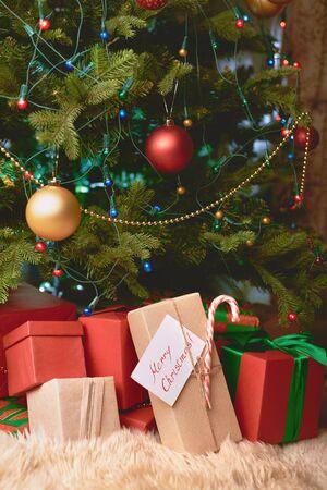 under: Heap of Christmas gifts under fir-tree
