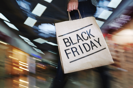 black: Female shopper visiting mall on Black Friday Stock Photo