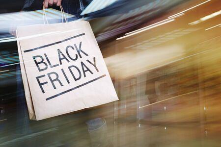 paperbag: Black Friday paperbag carried by modern customer