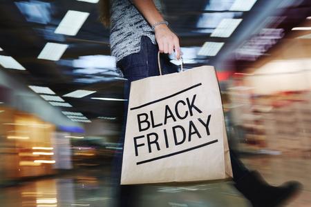 paperbag: Walking shopper with Black Friday paperbag