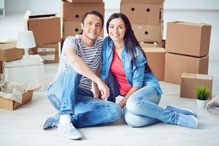 settler: Portrait of young happy couple moving in new home