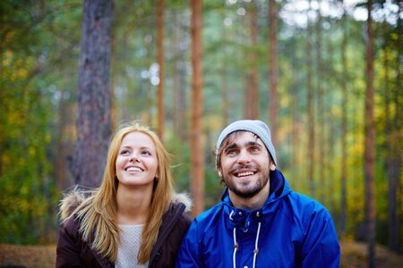 boy lady: Happy young couple in the forest Stock Photo