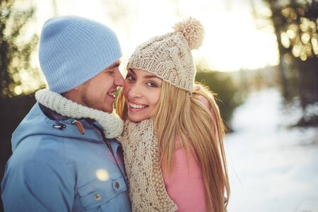 romantic date: Lovely couple enjoying winter day together