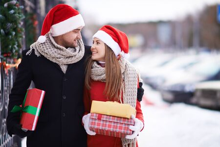 christmas gifts: Beautiful couple carrying Christmas gifts Stock Photo