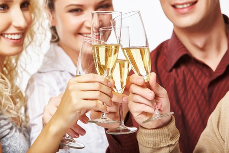 bubbly: Happy men and women toasting with bubbly champagne Stock Photo