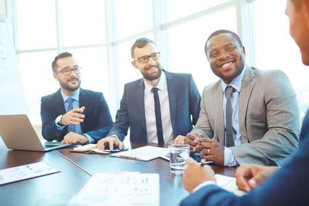 negotiating: Happy businessmen discussing seminar or negotiating with partner