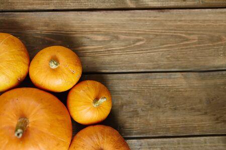 harvest background: Orange pumpkins on the table