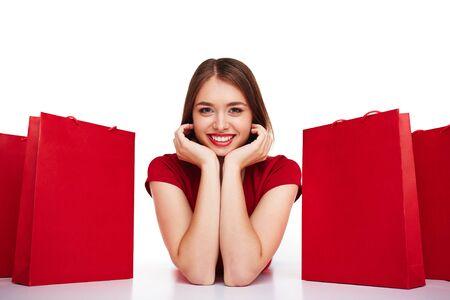 happy shopper: Beautiful woman smiling among shopping bags Stock Photo