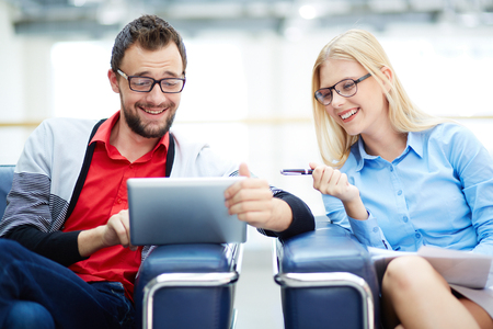touchpad: Cheerful business colleagues using touchpad for working