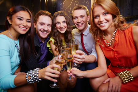 A group of friends toasting with glasses of champagne