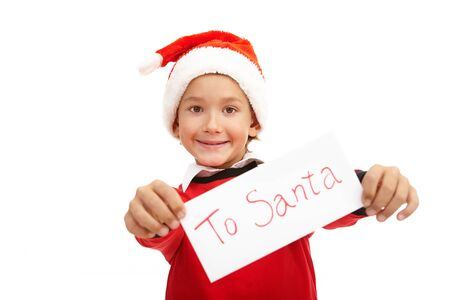 Happy boy in Santa cap showing Christmas letter photo