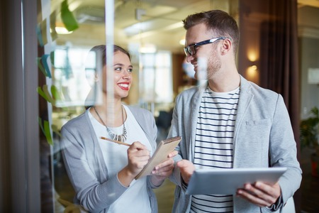 employee: Happy employees planning work or discussing plans