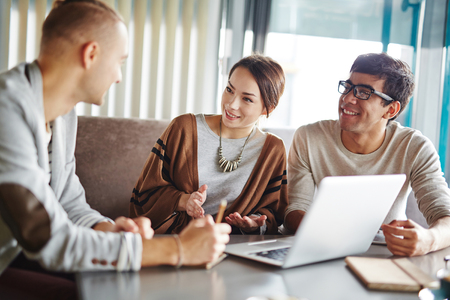 discussion: Group of people discussing plans in informal atmosphere Stock Photo