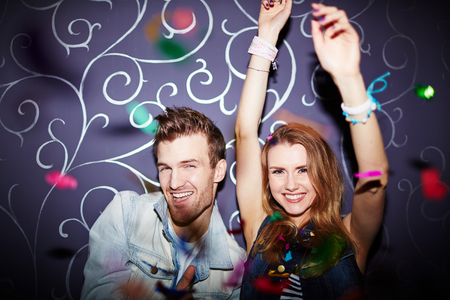 adult entertainment: Happy young couple dancing in night club Stock Photo