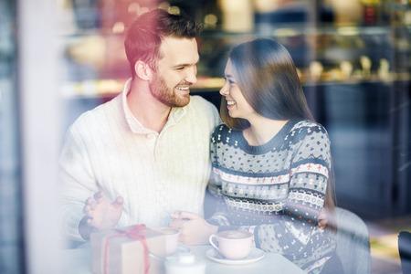 amorous woman: Romantic dates enjoying time in cafe