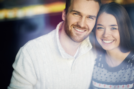 happy couple: Affectionate couple looking at camera with smiles Stock Photo