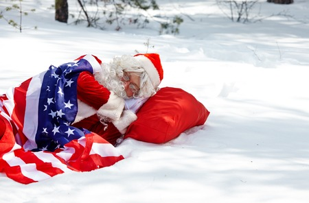 snowdrift: Santa Claus sleeping in winter forest Stock Photo
