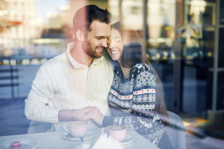 young happy couple: Amorous dates enjoying rest in cafe