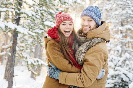 amorous woman: Ecstatic dates in winterwear enjoying nice time Stock Photo