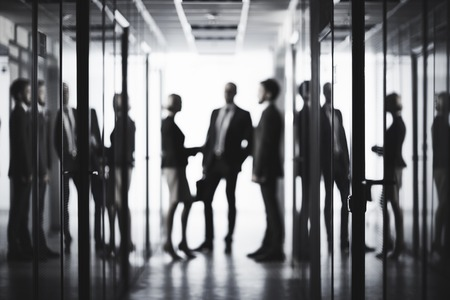 People: Black and white image of business people at office